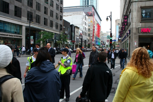 Cadets stop pedestrians from crossing on a flashing hand (in one direction only)