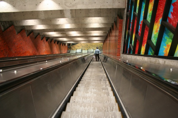 A frustrated transit user walks down one of Montreal's longest escalators