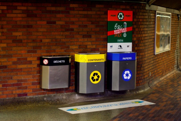 """Yellow """"contenants"""" bin accepts plastic bottles for recycling"""
