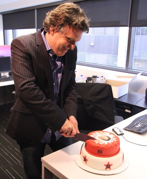 Andrew Carter cutting cake
