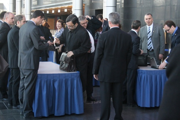 Officials inspect electronic devices to ensure their wireless capabilities are turned off