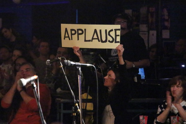 8:22pm: Laura Dalton Black holds up the applause sign as the show begins