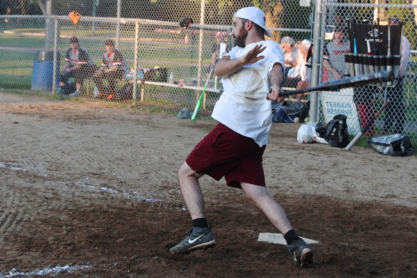 Ajay Hoffer-Holobow gives the swing his all. His fielding at short stop made him the star of the team.