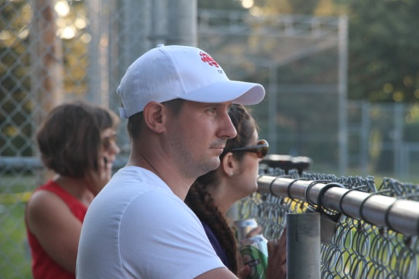 Dan Halton watching from the bench, with Catherine Cullen (left) and Andie Bennett (right)