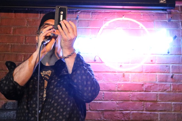 Mitch Melnick tries to take a selfie at the beginning of his set.