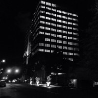 The State Farm (previously Frank Russell) Building shining at night
