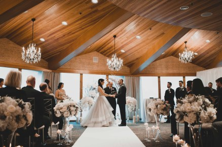 Flora Nova Design Seattle - Luxurious Winter Wedding at the Edgewater Hotel. White and Grey Ceremony Arch with Phalaenopsis Orchids