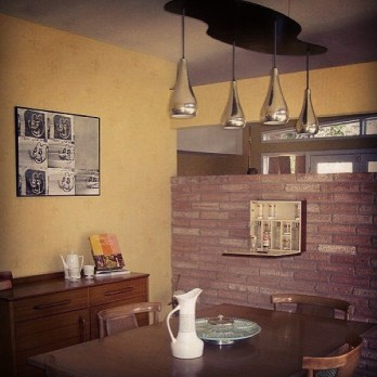 Dining-in-Glenbrook-Valley-with-original-light-fixture-mcmbar-barcabinet-retro-retrodining-mccobbcon