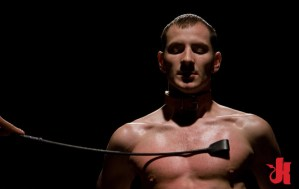 Muscular teenager is tied up in a dark basement and whipped with a riding crop
