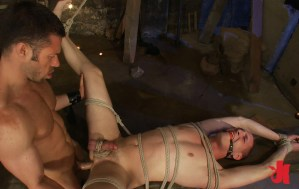 Gagged and tied up slave gets his ass fucked hard by a dominating man while on a table