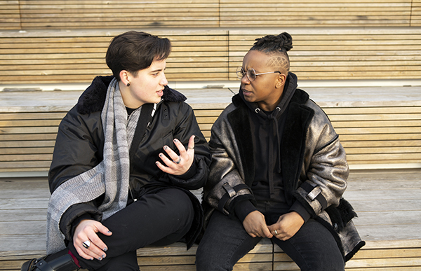 Two people having a serious conversation. Photo Courtesy of The Gender Spectrum Collection /Creative Commons