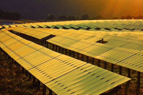 sunset over solar energy field