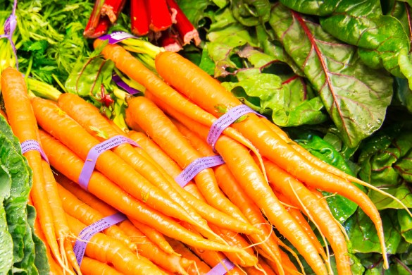 Display of fresh vegetables - Carrots, Lettuce, Greens