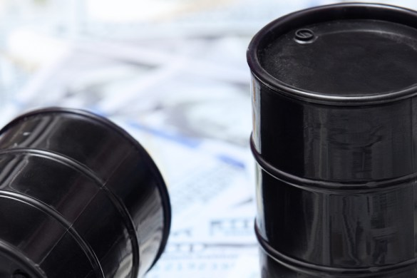 Oil drums on US dollars background, opec, fuel