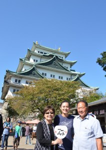 Camryn and her parents in front of Nagoya Castle.