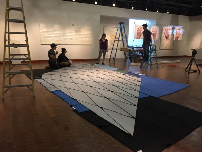 The crew prepares to install the most challenging piece, Jiangmei Wu's Ruga Swan (2014). Photo by Vicky Murakami.