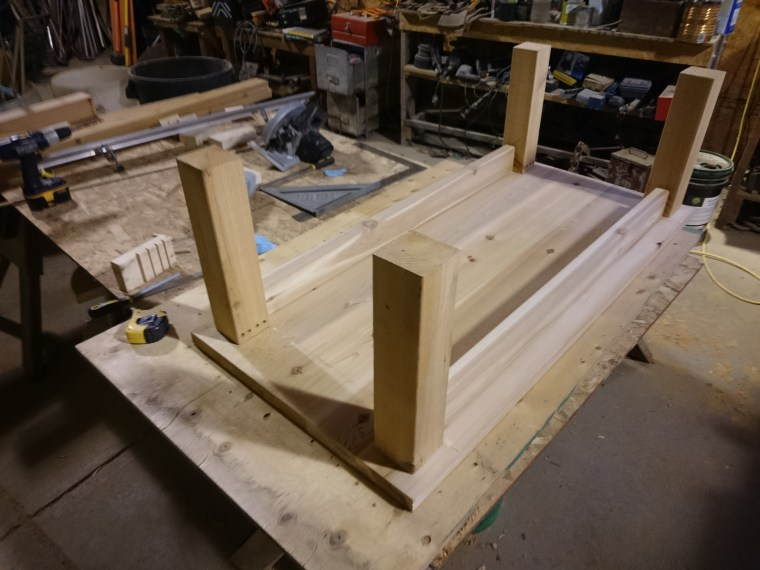 The dowels all put together with the legs and top part of the frame assembled.