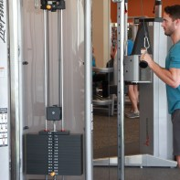 James-performing-tricep-push-down-drop-set-at-LA-Fitness-1