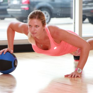 Danica performing single arm medicine ball push-ups at LA Fitness - 2