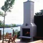 An outdoor fireplace such as this one from Broadys adds ambience and warmth to your backyard no matter what the season.