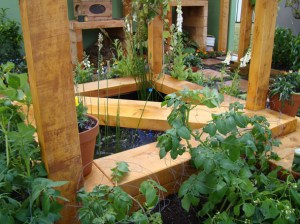 "The central ""Eel Tank"" is carefully planted with plants for the bees & as well as veges for us."