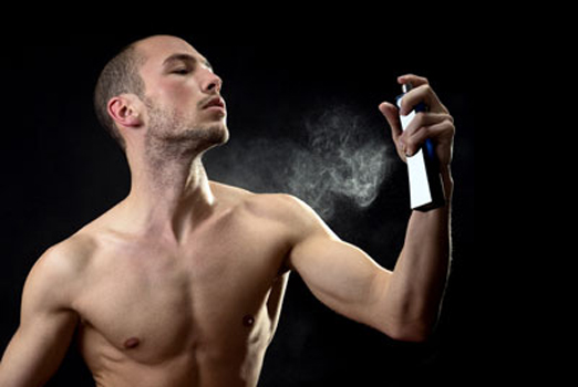 Man spraying fragrance