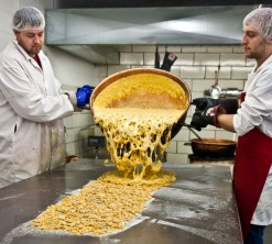 Liquid brittle is poured onto the hot table. The sugar and cooled brittle melts instantly as the hot brittle hits the table.