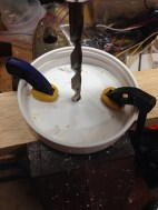 Once lid is pierced, switch to the bigger drill bit.