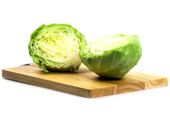 head of cabbage on cutting board