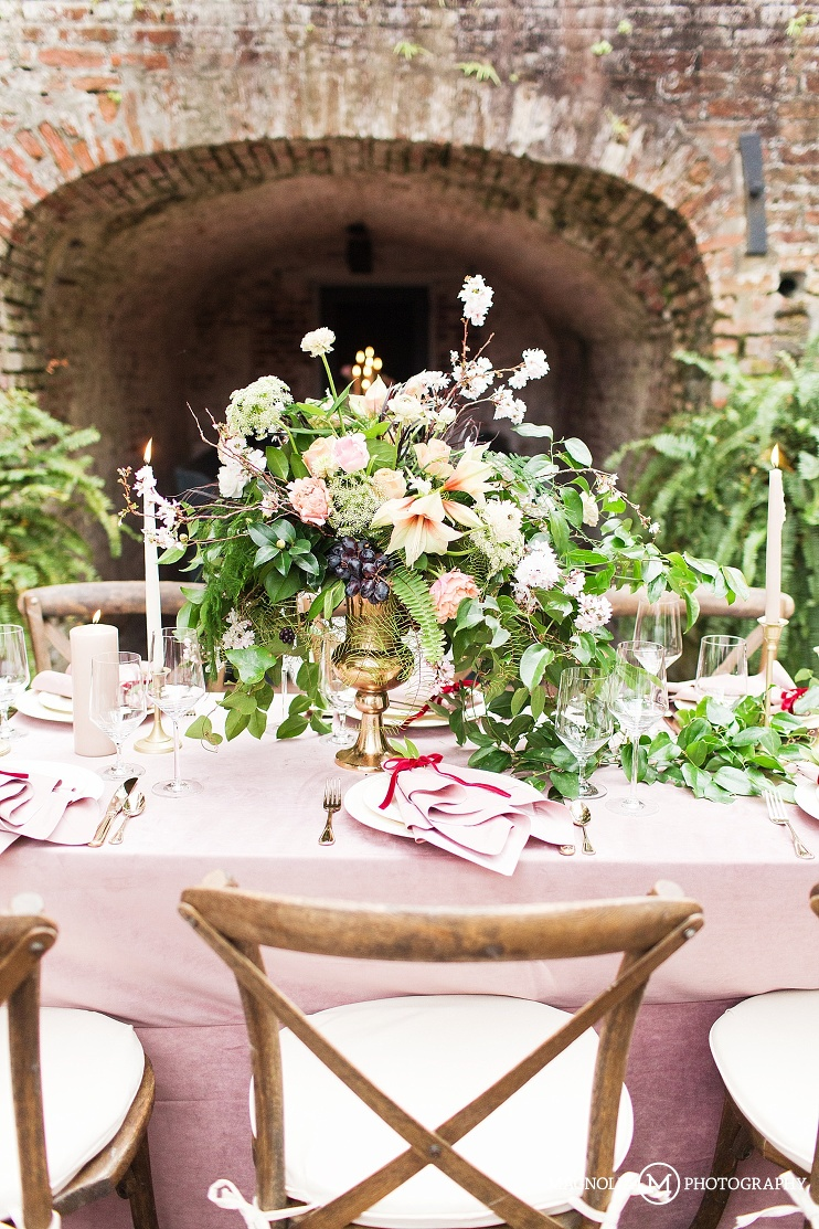 styled shoot table scape with large floral centerpiece