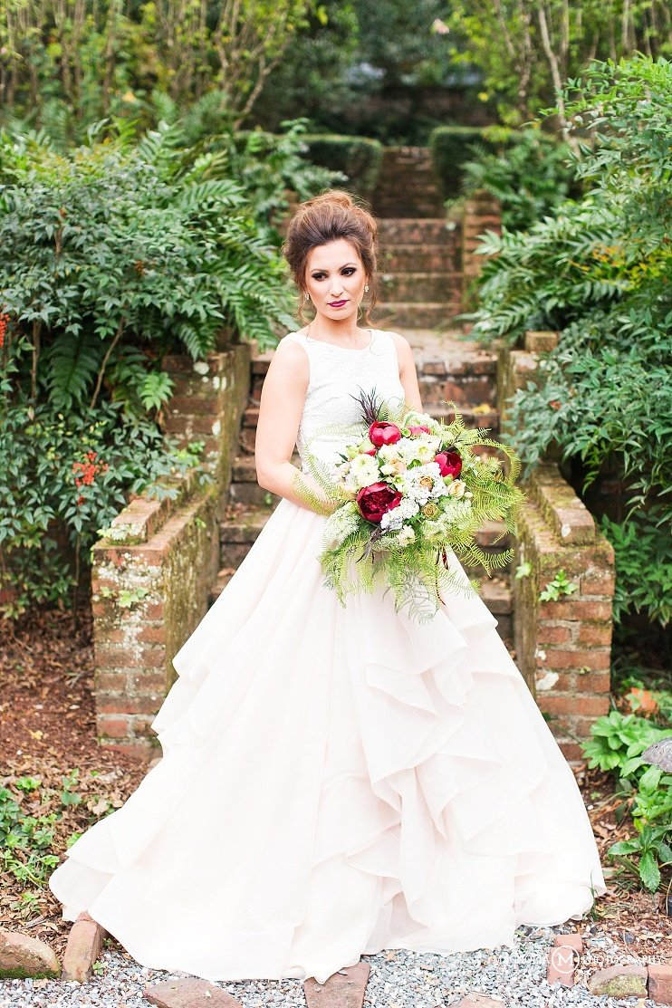 bride in crop top and flowy layered bridal skirt