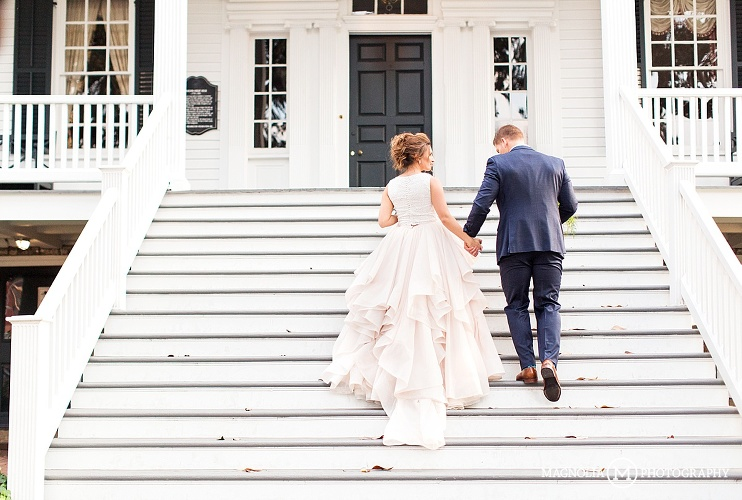 bride and groom walking up steps