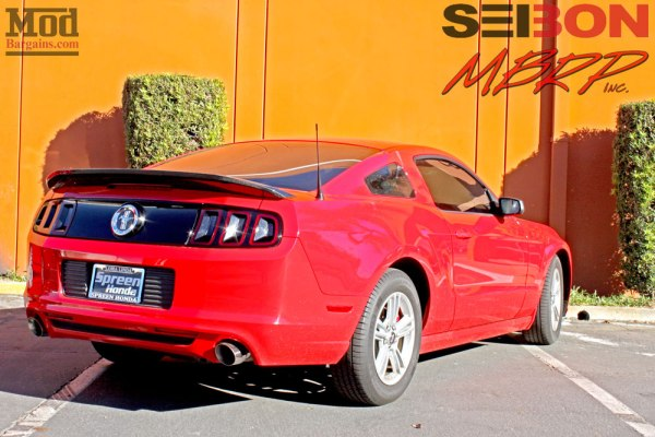 S197 Ford Mustang gets MBRP Exhaust, SEIBON CF Spoiler & MGP Caliper Covers @ ModAuto