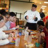 Chef Steven Miller of Cornell University, New York state talking to diners at table