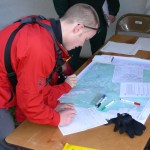 SAR Member using a map