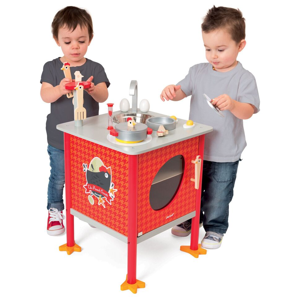 children playing with kitchen toy