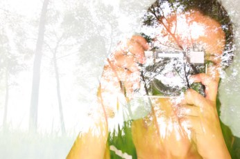 double exposure image of young girl holding old camera and natur