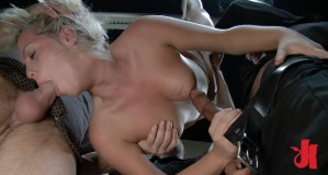 Suspended and tied up blonde gets throat fucked and is forced to jerk off a huge cock