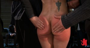 Stunning woman gets her ass cheeks spanked in public while having her hands tied