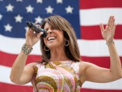 Woman-singing-in-front-of-American-flag