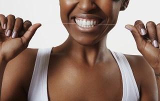woman with a dental floss. Bite a floss