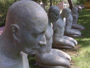 Photo of statues kneeling in park