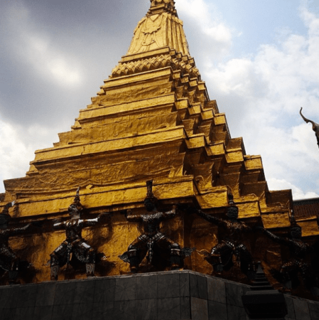 """""""This is a picture of giants holding up something that looks like a pyramid but it's a temple. I like it because it is gold and it has giants holding it up."""""""