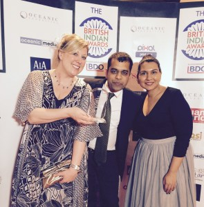 Faye, Amit and Tara posing with our award!
