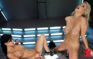 Two gorgeous women enjoy getting fucked in their cunts by two huge fucking machines