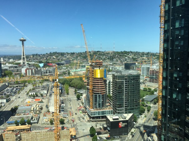 Numerous tower cranes dot the Denny Triangle with the Space Needle and Queen Anne in the background.