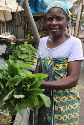 Aurelia sells her vegetables at the marketplace.