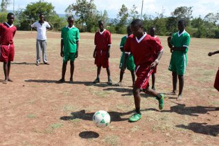 Kenyan youth playing soccer