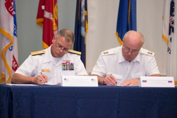 150610-N-OX801-072 NAVAL SUPPORT ACTIVITY CAPODICHINO NAPLES, Italy (June 10, 2015) Head of the U.S. Delegation, Rear Adm. John Nowell Jr., and Head of the Russian Delegation, Vice Adm. Oleg Burtsev, sign documents at the conclusion of an annual Prevention of Incidents On and Over the High Seas (INCSEA) review at Naval Support Activity Capodichino Naples, Italy, June 10, 2015. These annual reviews are a professional discussion of the agreements in place to prevent incidents or collisions at sea between U.S. and Russian ships and aircraft. (U.S. Navy photo by Mass Communication Specialist 3rd Class Daniel P. Schumacher/Released)