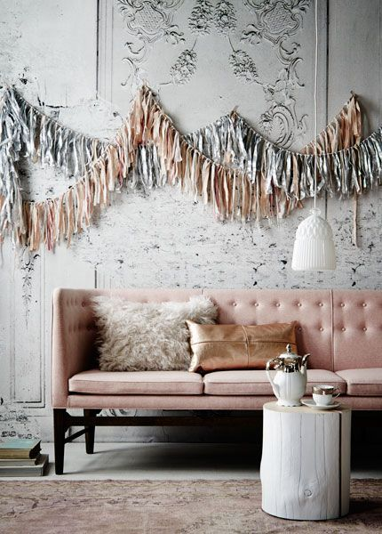 Love the copper-coloured leather pillow on the pink sofa, totally now - via Dutch VT Wonen